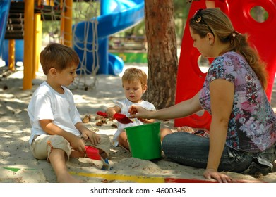Happy family at outdoor playground