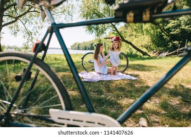 Happy family outdoors spending time together. Father, mother and daughter in the picnic on a beach