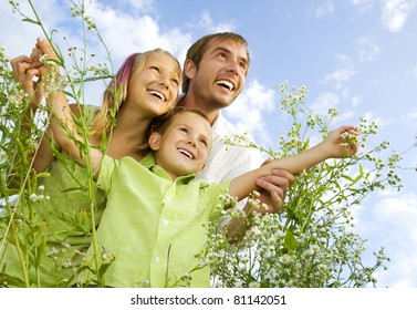 Happy Family Outdoors.Father with kids over blue sky