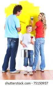Happy family painting interior wall of home.