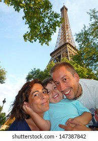 Happy family in Paris holidays. Eiffel Tower