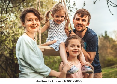 Happy family in the park evening light