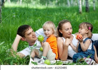 Happy family in park having picnic