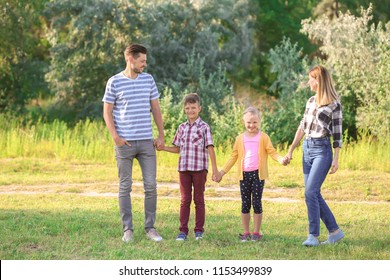 Happy family in park on summer day