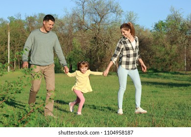 Happy family in park on sunny day