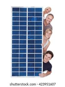 Happy Family Peeping Through Solar Panel Against White Background