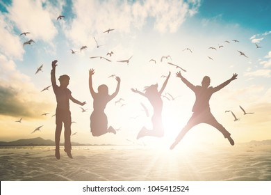 Happy family person group jump on fly bird beach background concept for good of togerther team mlm retreat, wealthy life insurance. Students people feel good celebration for victory Holiday hours.
