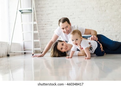 happy family play in big white room after repair