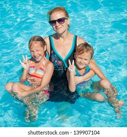 happy family playing around in the pool