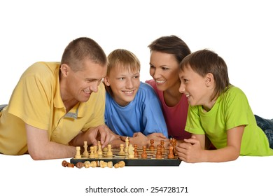 Happy family playing chess isolated on white