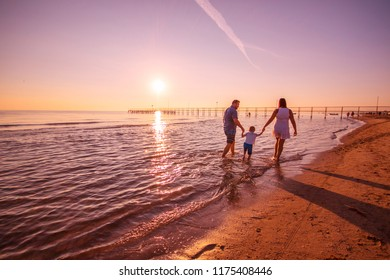happy family playing on the shore