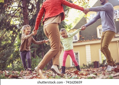 Happy family playing outside.