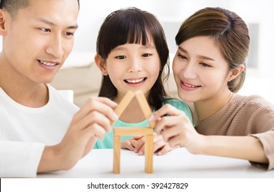 happy family playing with toy blocks