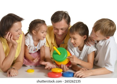 Happy family playing with toy,isolated on white