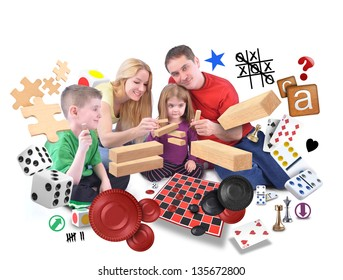 A happy family is playing with various games of puzzles, blocks and checkers on an isolated white background.