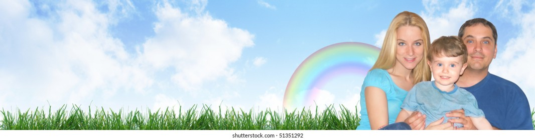 A happy family portrait is against a nature outdoor background with clouds and grass. Use as a header and add your text to the copyspace.