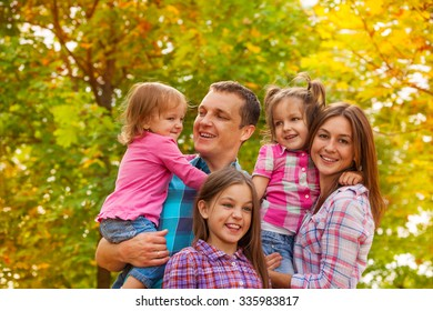Happy family portrait with little girls outside