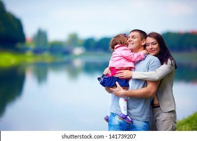 happy family portrait, outdoors