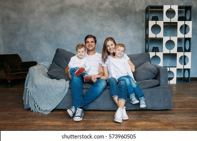 Happy family portrait sitting on sofa at home living room