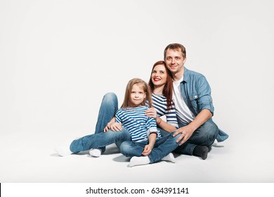 Happy family portrait sitting on white background isolated