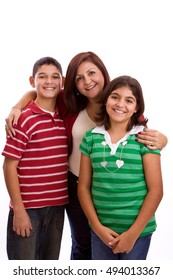 Happy family portrait smiling together - isolated over white background.