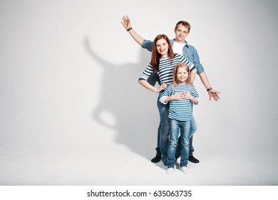 Happy family portrait standing on white background isolated