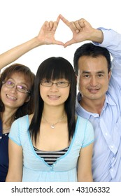 Happy Family poses for portrait in studio