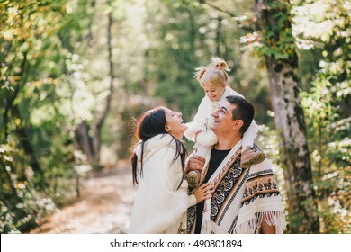 Happy family posing in an autumn forest