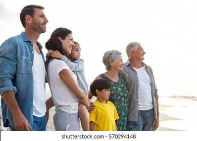 Happy family posing at the beach on a sunny day