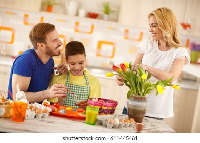 Happy family preparing Easter celebration in kitchen