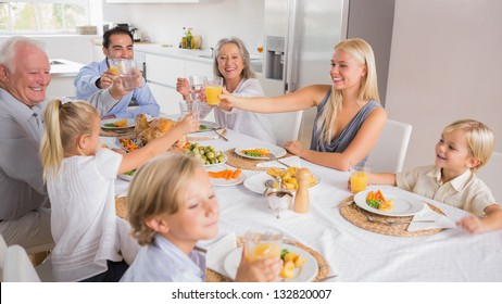 Happy family raising their glasses together for thanksgiving