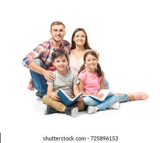 Happy family reading books on white background
