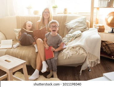 Happy family reading books together