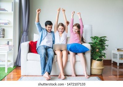 Happy family relaxing at home on sofa, having fun, friendship between siblings, family leisure time in living room.