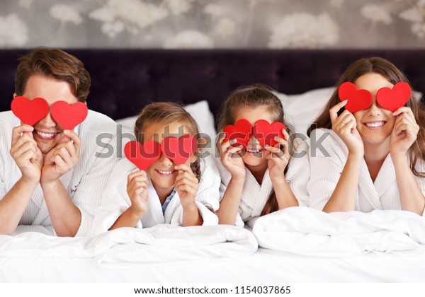 Happy family relaxing in hotel room