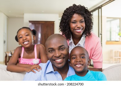 Happy family relaxing on the couch at home in the living room