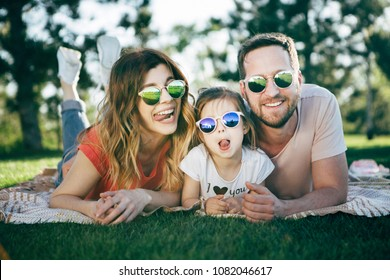 Happy family rest together in open air.
