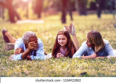 Happy family resting in a park. Vintage and soft focus concept.