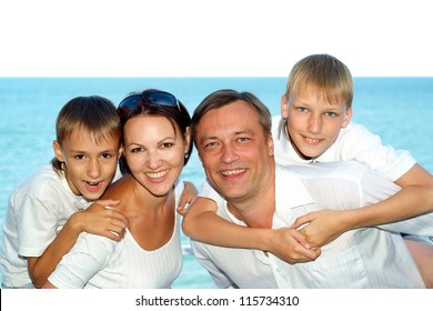 Happy family resting at the resort together