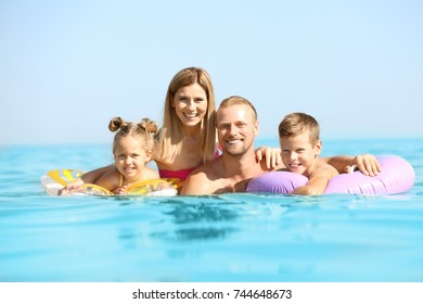 Happy family resting at sea resort
