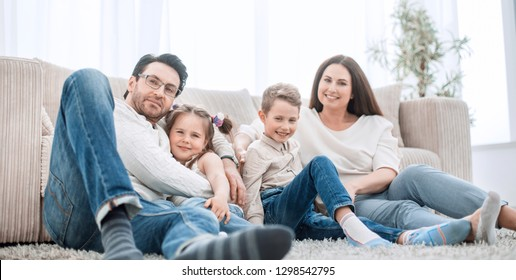 happy family rests in the living room on a free evening