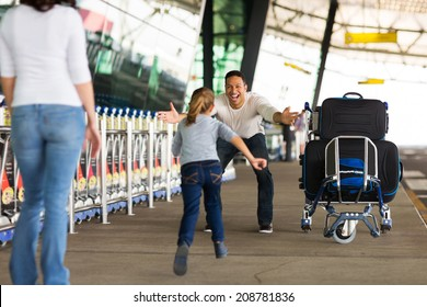happy family reunion at airport