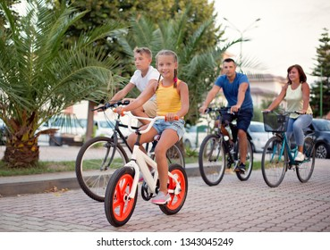 Happy family riding bicycles
