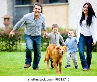 Happy family running at the backyard and having fun