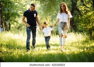 Happy family running in the park