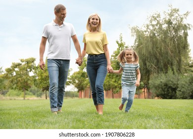 Happy family running in park on summer day