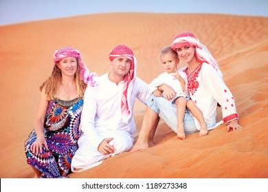 Happy family in Sahara Desert, Dubai, UAE