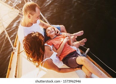 Happy family sailing on a luxury yacht or catamaran boat