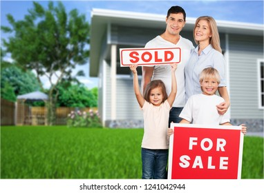 Happy Family with for sale sign isolated on white background