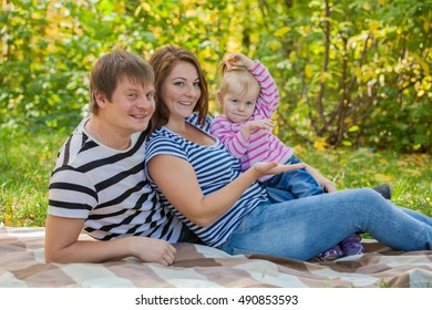 happy family in the same clothes for a walk in the park in autumn
